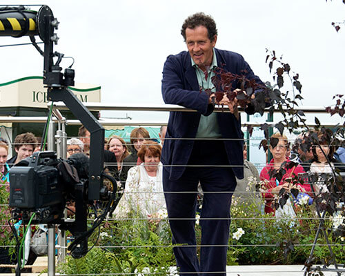 Monty Don filming at RHS Tatton Park Flower Show - leaning on an S3i Balustrade