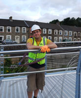 Jonny taking a break from rigging a footbridge