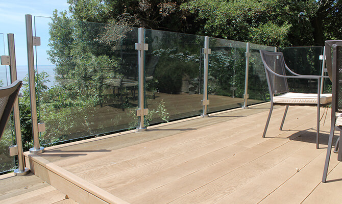 Glass Balustrade Directly Mounted on to Raised Decking Area