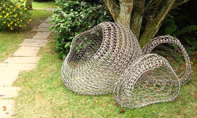 Large wire basket seats by Geraldine Jones