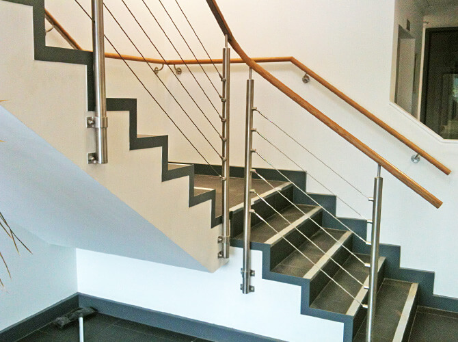 balustrade wire infill installation on a staircase