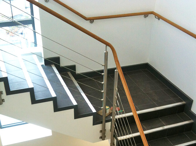 Balustrade wire infill installation as part of a office modernization project