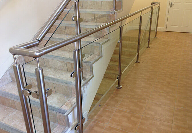 Staircase glass balustrade and stainless steel handrail.