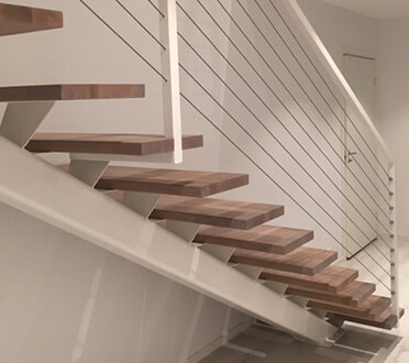 Stainless Steel Wire Infill with Timber Stairs and White Interior
