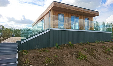 Eco Lodge with Frameless Glass Balustrade